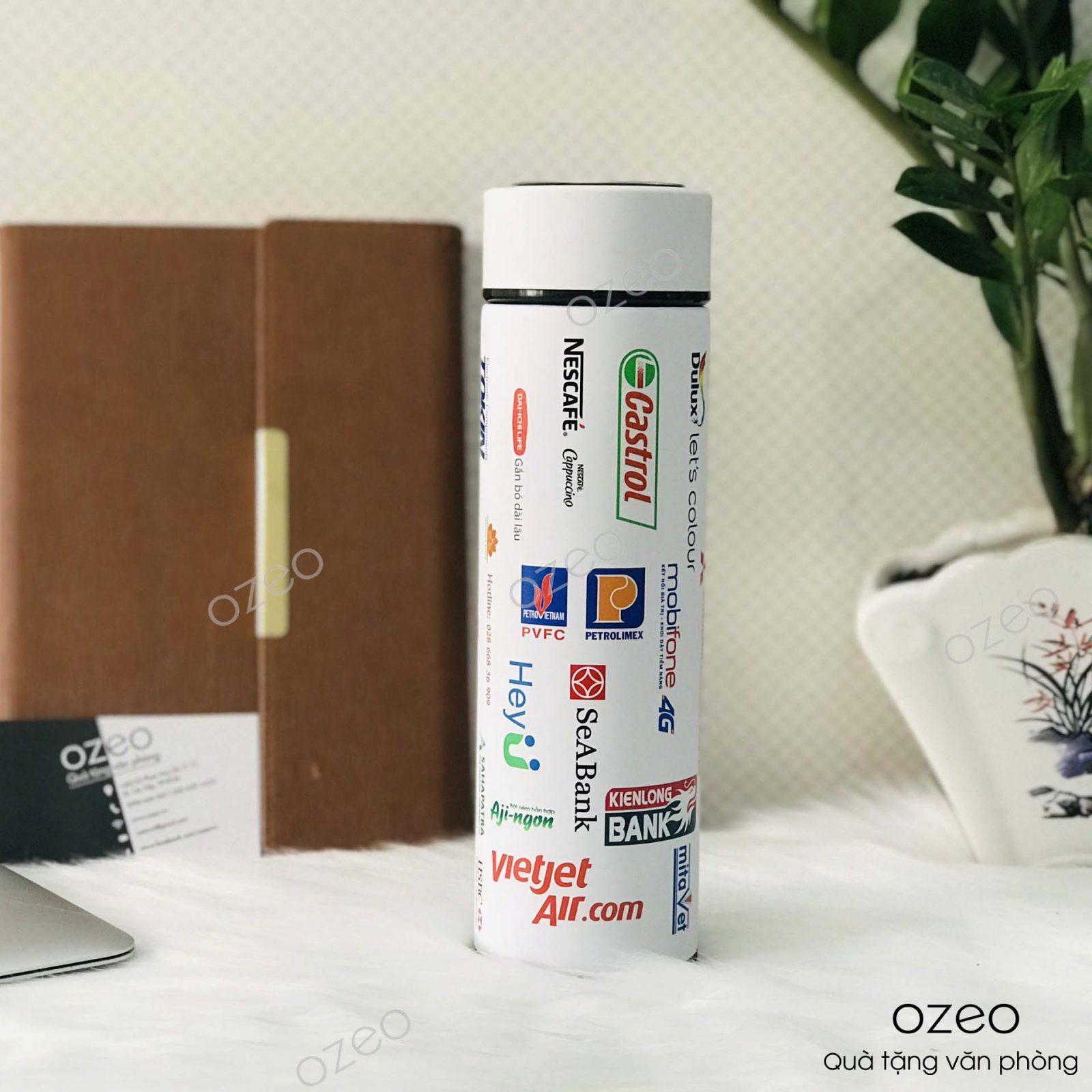 Bình giữ nhiệt GN01TR- màu trắng in logo thương hiệu, tên công ty nổi bật.